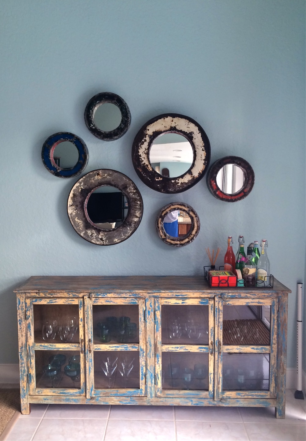Vintage Indian buffet with Bali oil drum mirrors...