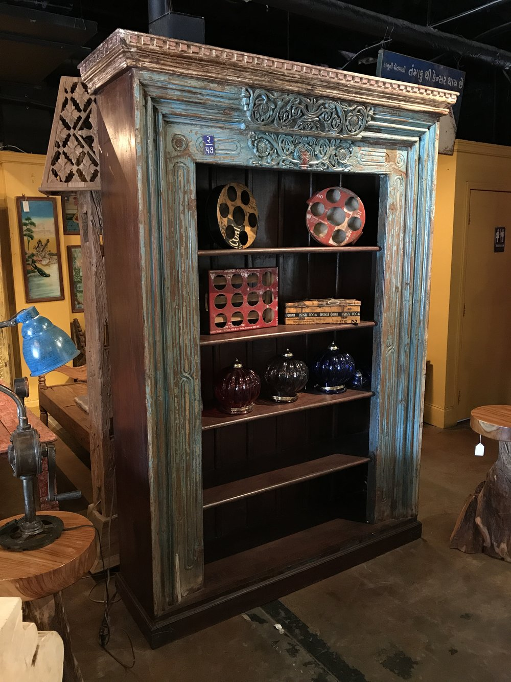 "Indian bookcase made with a salvaged antique Rajasthani doorframe.  67""w x 20""d x 93.25""h  $2895.00 #CH-19B"