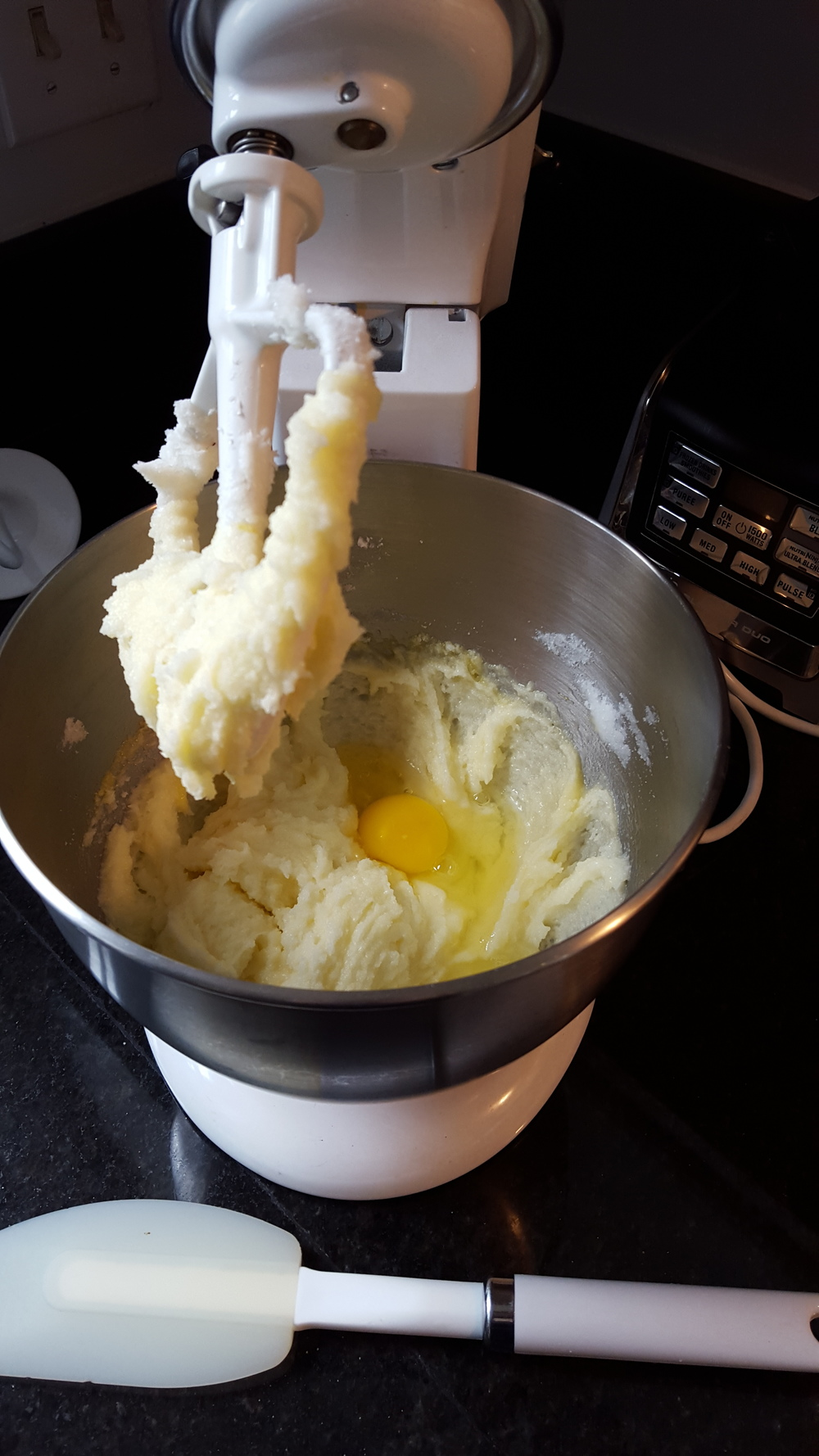 Add 5 eggs, one at a time.