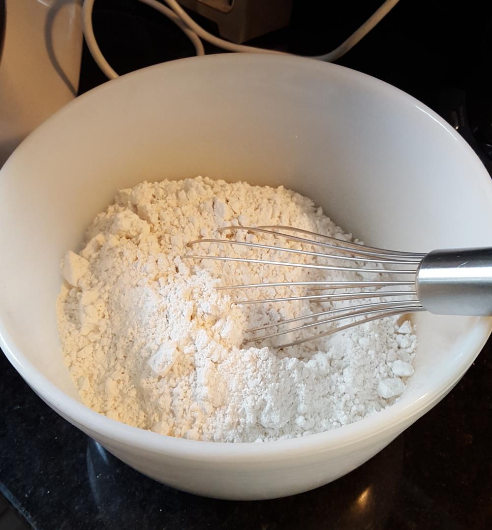 Wisk together flour, salt, baking soda.