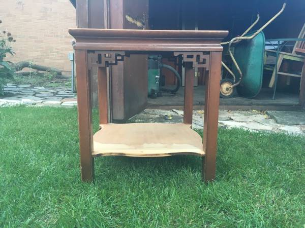 Chinese Chippendale end table. Needs a little bit of help, but it's only ten bucks!  https://chicago.craigslist.org/chc/fuo/5778844667.html