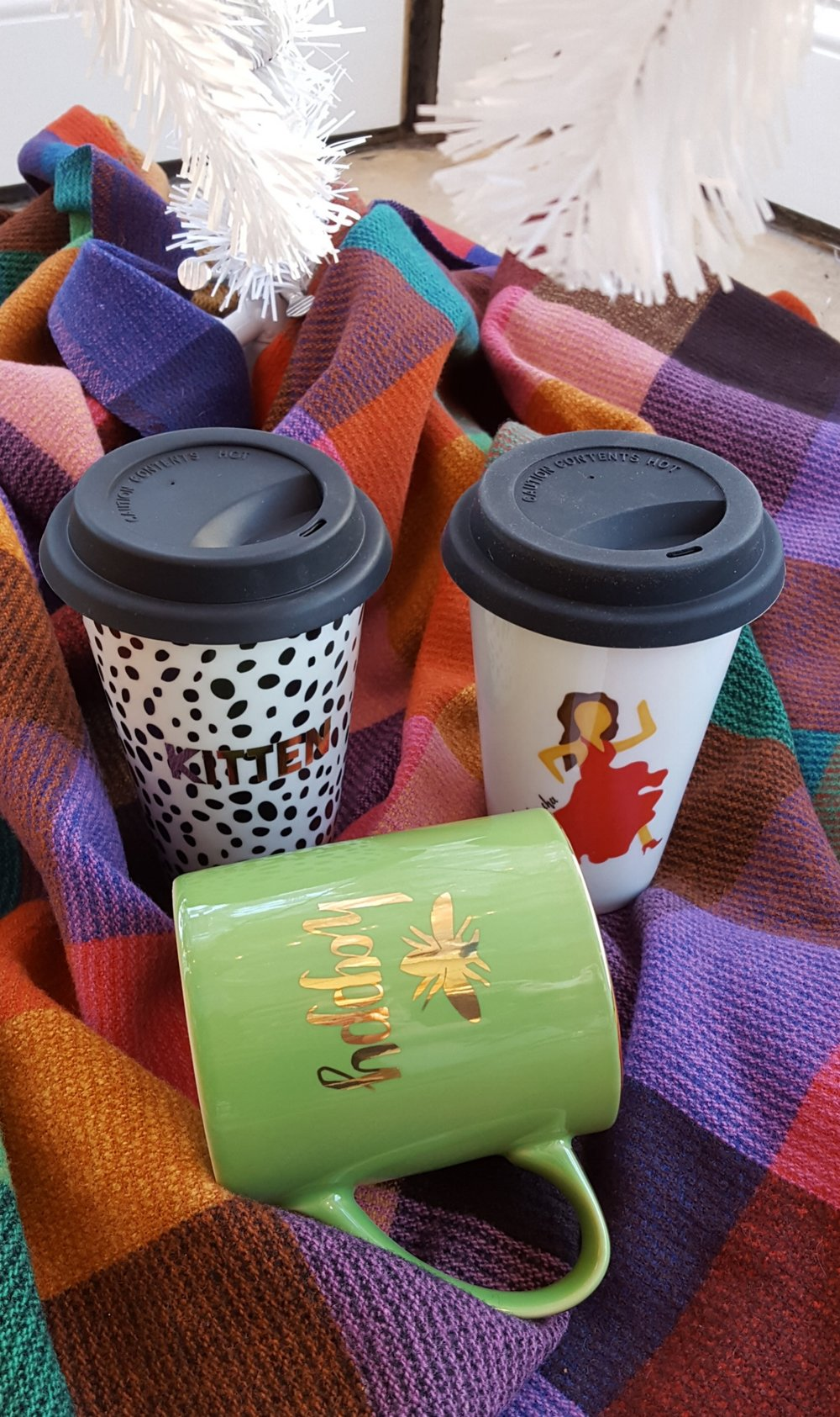 Kitten and Cha Cha travel mugs: $18 each, Bee Happy mug: $12