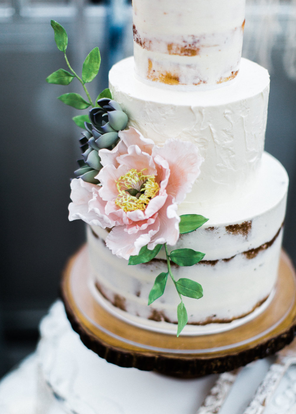 Sugar peony with succulents and foliage. Image copyright Alexandra Knight Photography.