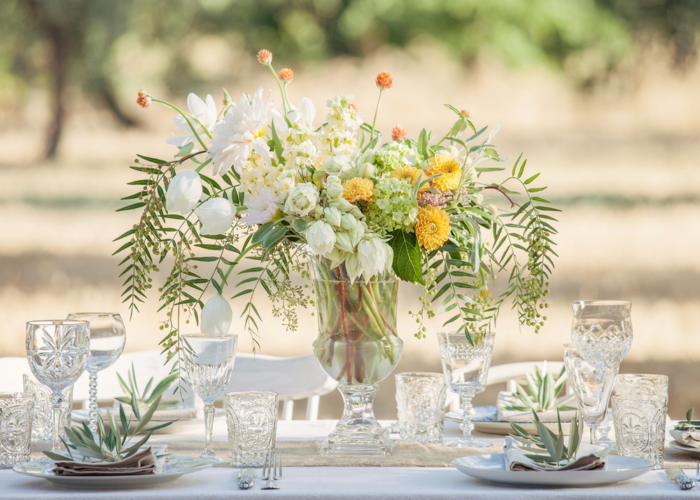 These summer flowers were selected in bright but soft hues to compliment the silver in the olive branches and golden grasses.