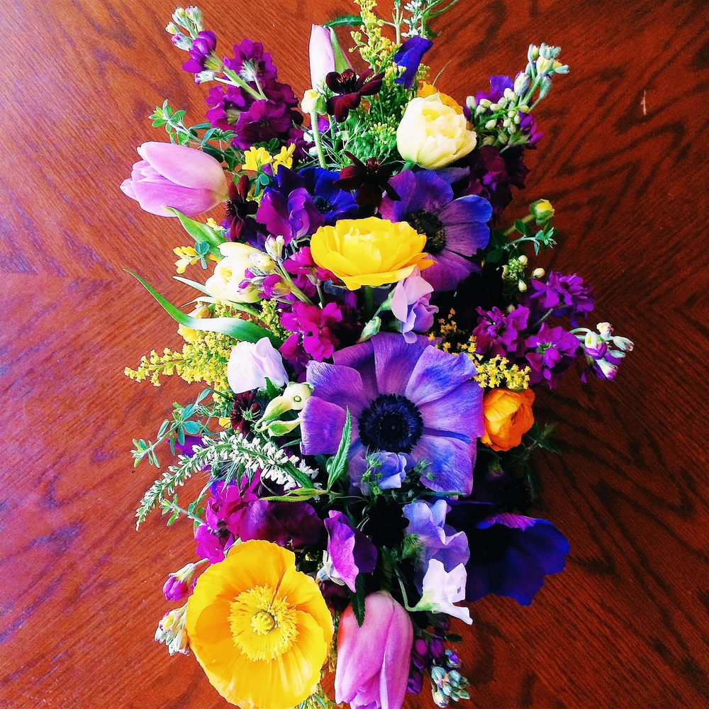 Bright purple hues with yellow & orange accents for these dinner party centerpieces.            Event: Dinner Party, Vacaville, CA