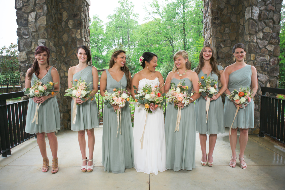the maids of honor wore long gowns and the bridesmaids wore shorter.  all the maids were encouraged to choose their own neckline so they'd feel their most gorgeous for the wedding!