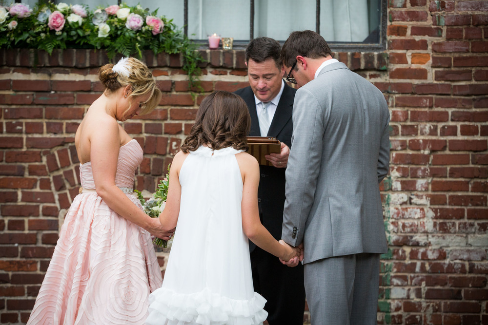 a ceremony filled with love and the promise to go forth as a family was just perfect for this couple