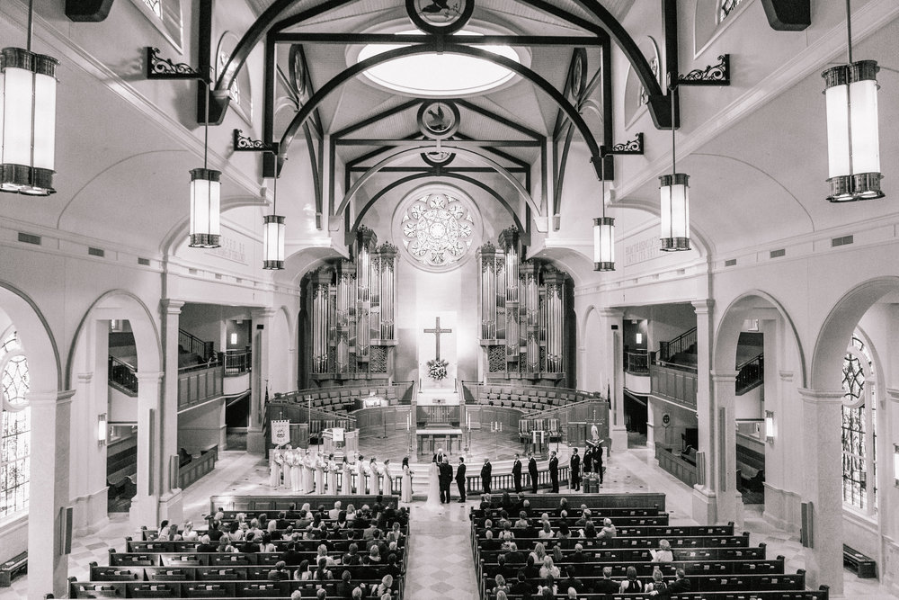 a traditional church wedding with 11 bridesmaids and 9 groomsmen at peachtree road united methodist church in atlanta