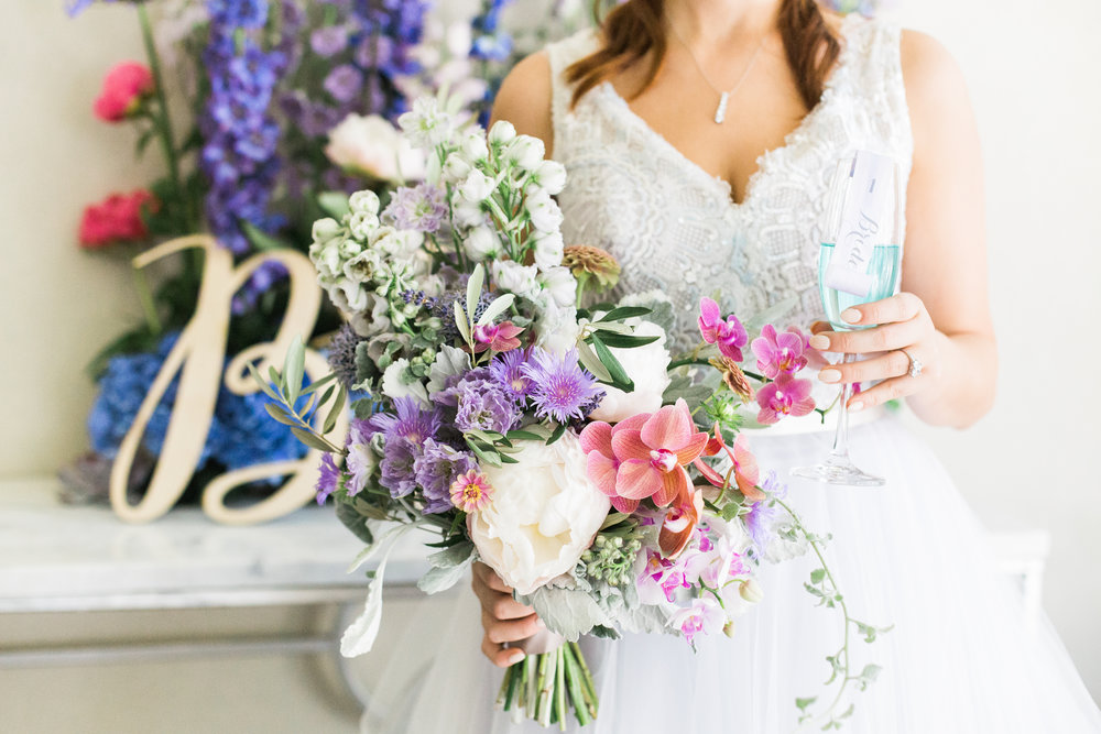lilac, lavender & periwinkle luxury wedding bouquet at cannon green charleston by scarlet plan & design for revolution wedding tours
