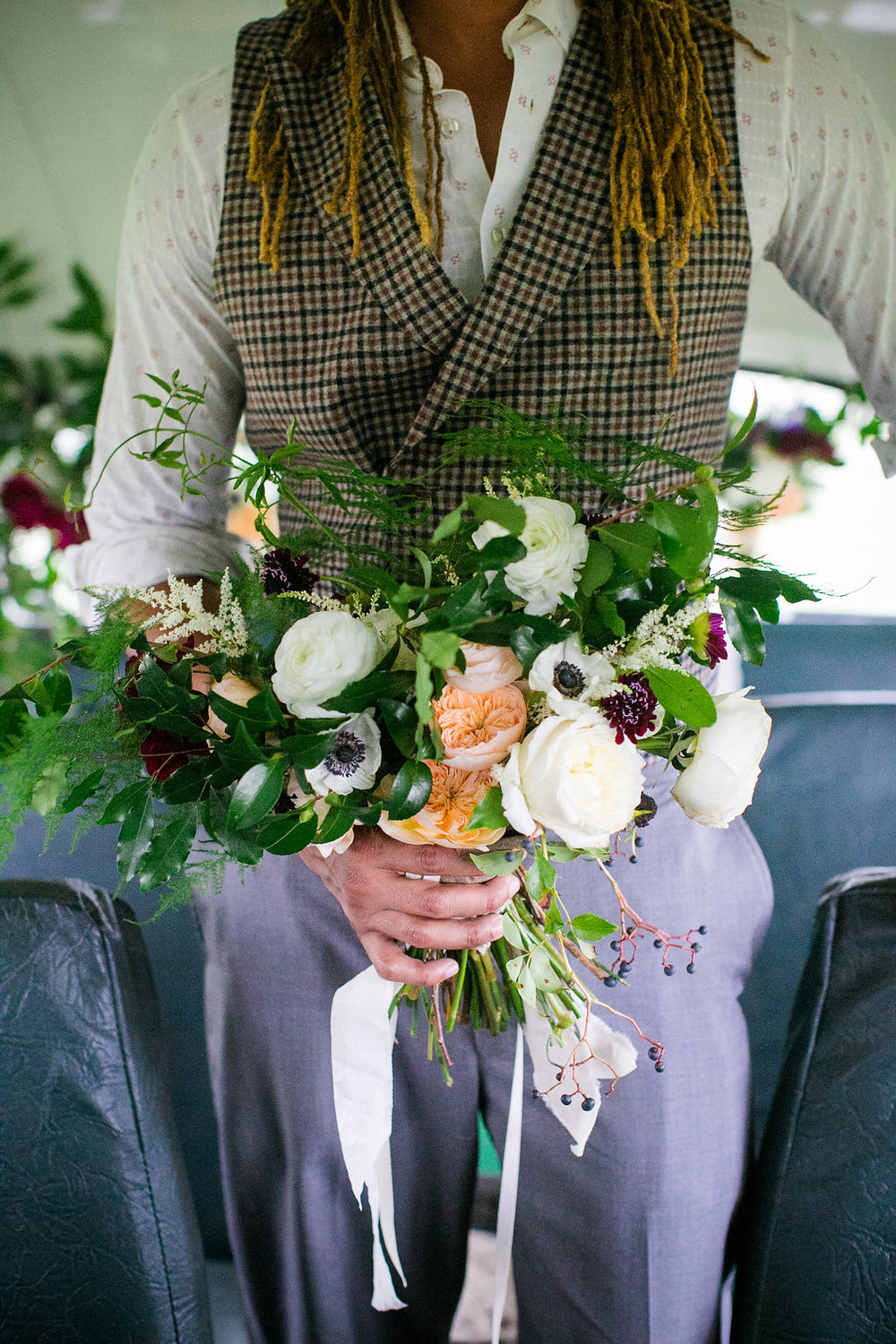 organic, foraged bridal bouquet with peach David Austen garden roses, white David Austen roses, white ranunculus, white anemones, blush ranunculus, burgundy scabiosa, hypericum berries and tons of greenery | citadel beach house charleston wedding planners scarlet plan & design