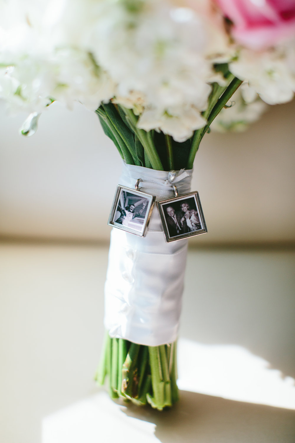 atlanta wedding planners bridal bouquet with photos of family