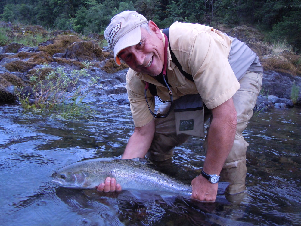 Tim Filice with his first dry fly steelhead. The smile says it all, he was pumped.