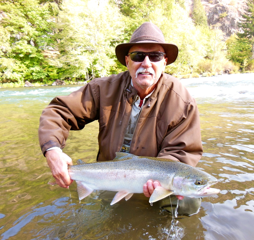 "Vincent Novits with his first North Umpqua steelhead. Vincent lost one of those epic fish the evening before, a fish that just crushed the fly and ""tore the river up""."