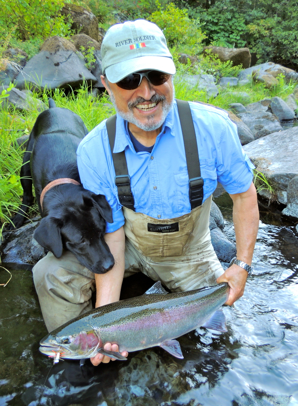 Henry Carlile with a nice one, this was the first steelhead Blue paid attention too. He's starting to understand what we're doing out there. No better to break him in than a lab lover too.