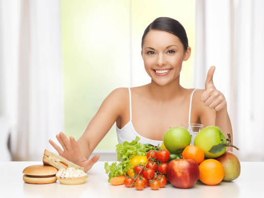 photodune-5442877-woman-with-fruits-rejecting-junk-food-xs.jpg