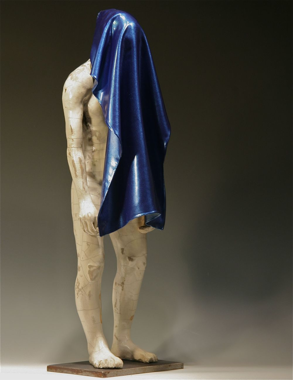 "2011 (Man with Blue Towel)  23""H, raku-fired stoneware, linen, polymers, paint"