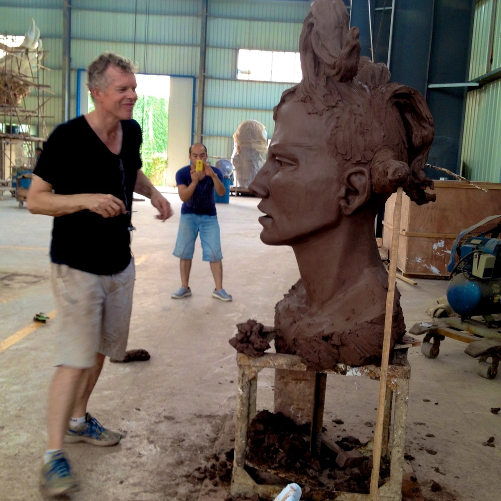 Bob modeling a clay head in Nanchang China, summer 2014