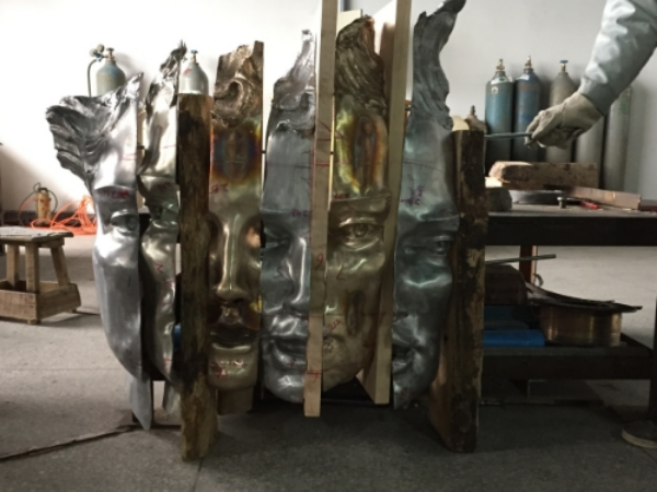 One more possible piece that is available-- Unstructured Presence - Cast Metal version -- shown here prior to final buffing and clear patina in foundry.  Free-standing it has a back but goes well against a wall.  The wood slices will be fuller, possibly one will be stone.