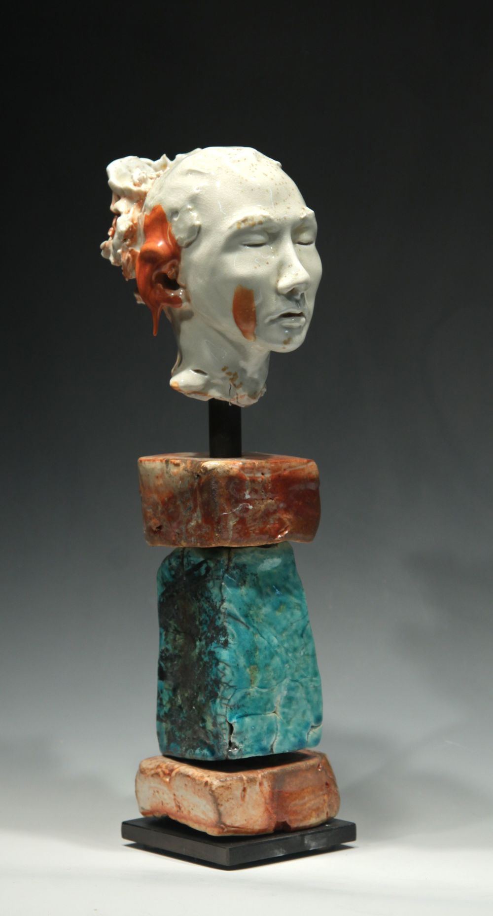 Woman's Head with Red Drip on Ear, noborigama-fired porcelain.  Head Sculpture