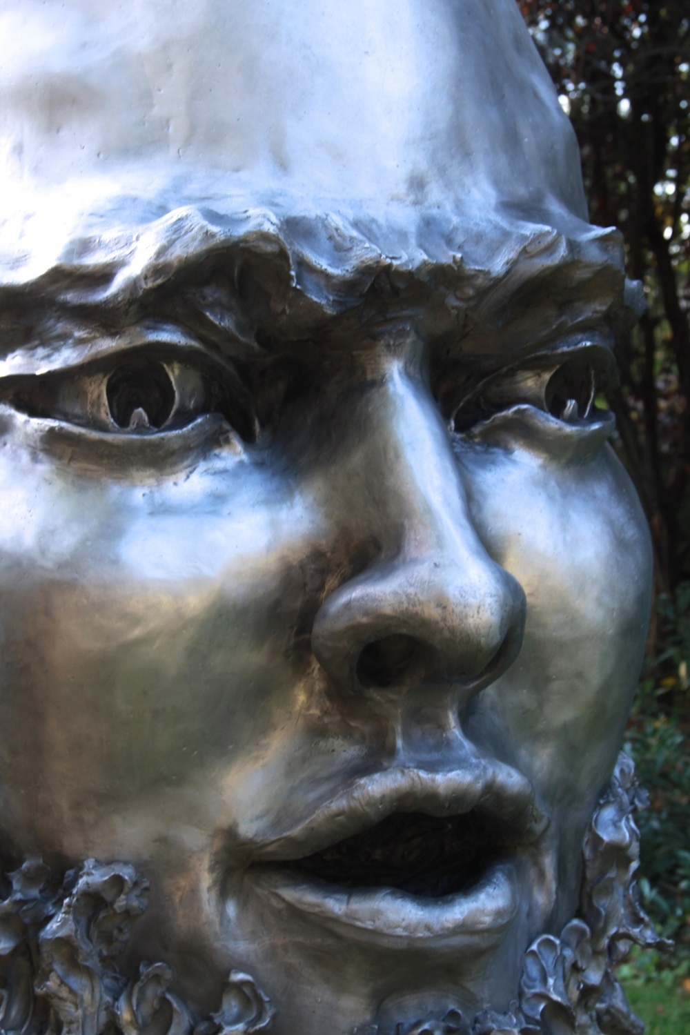 Fierce, outdoor sculpture (cast aluminum) bronze head sculpture, public art sculpture figure