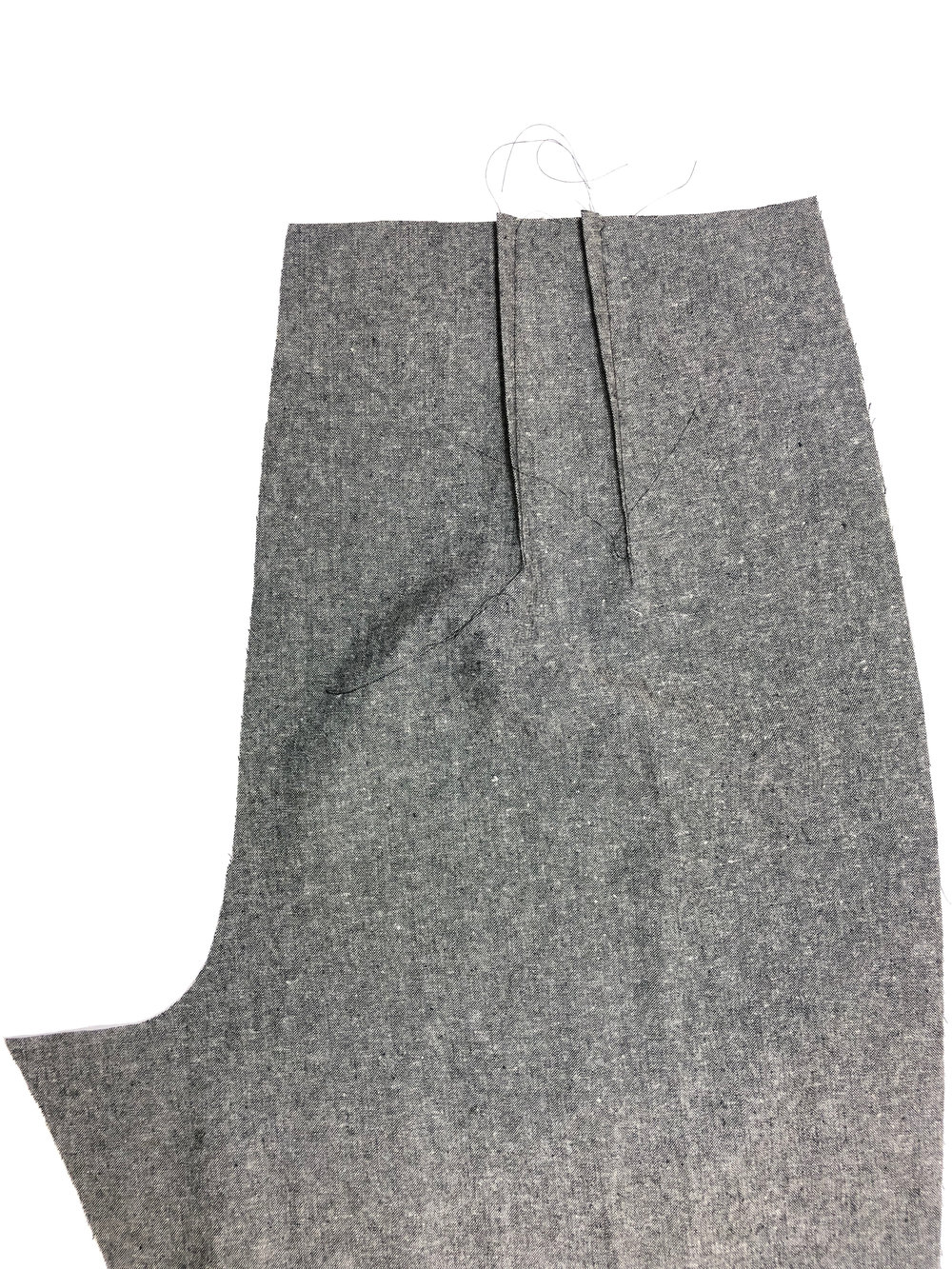 1. Stitch back pant darts from notches to dot mark, and press toward center back.