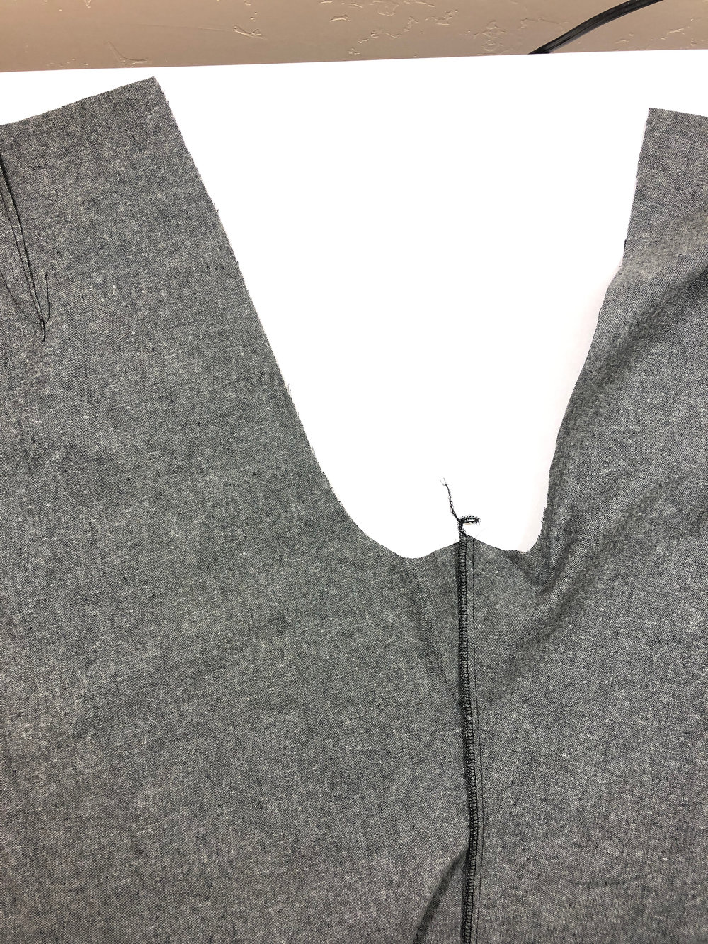 2. Serge/finish this seam, and press it towards the back pant leg.