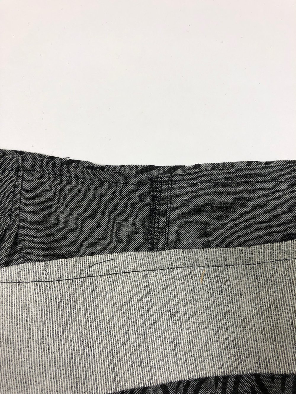 "3. Trim seam allowance to 3/8"", and grade the pants seam allowance to 1/4""."