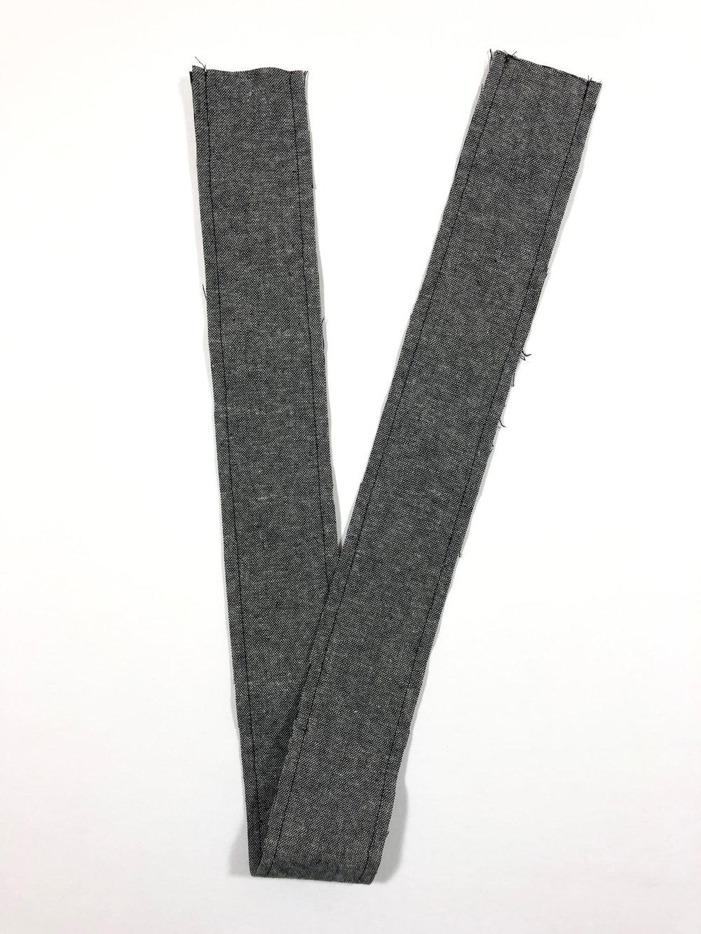 "62. Sew bib straps together with 1/4"" seam allowance."