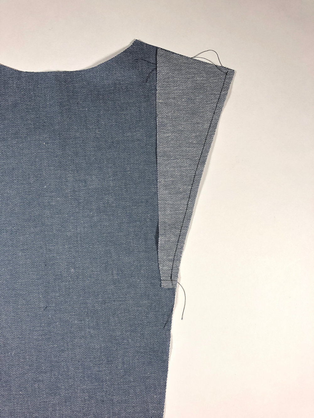 "24. With right sides together, stitch center back panel to pleat with 1/4"" seam allowance, stopping 1/4"" from the bottom of the pleat."