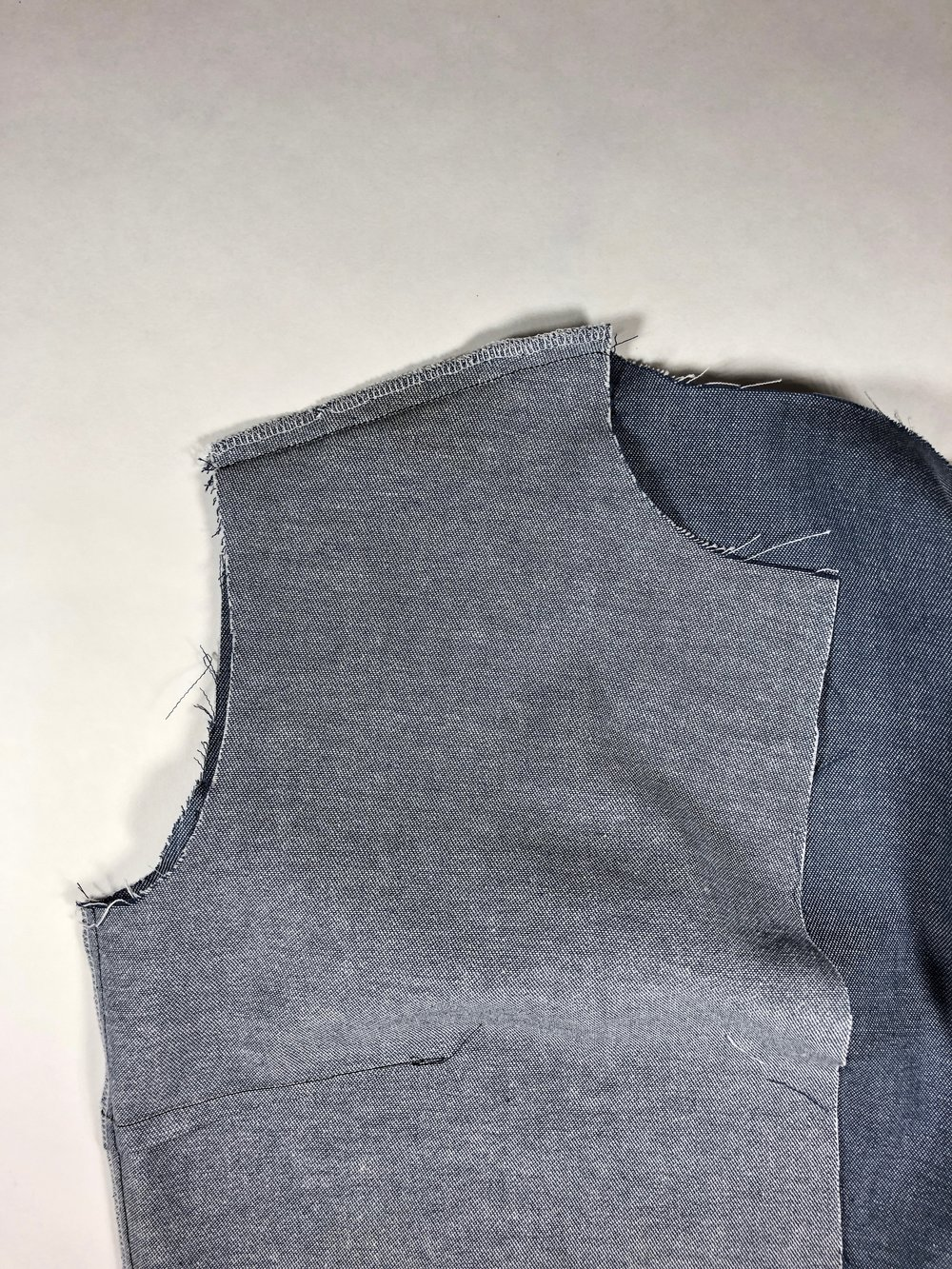 37. Press the side seam towards the back.  38. Press the shoulder seam towards the front.