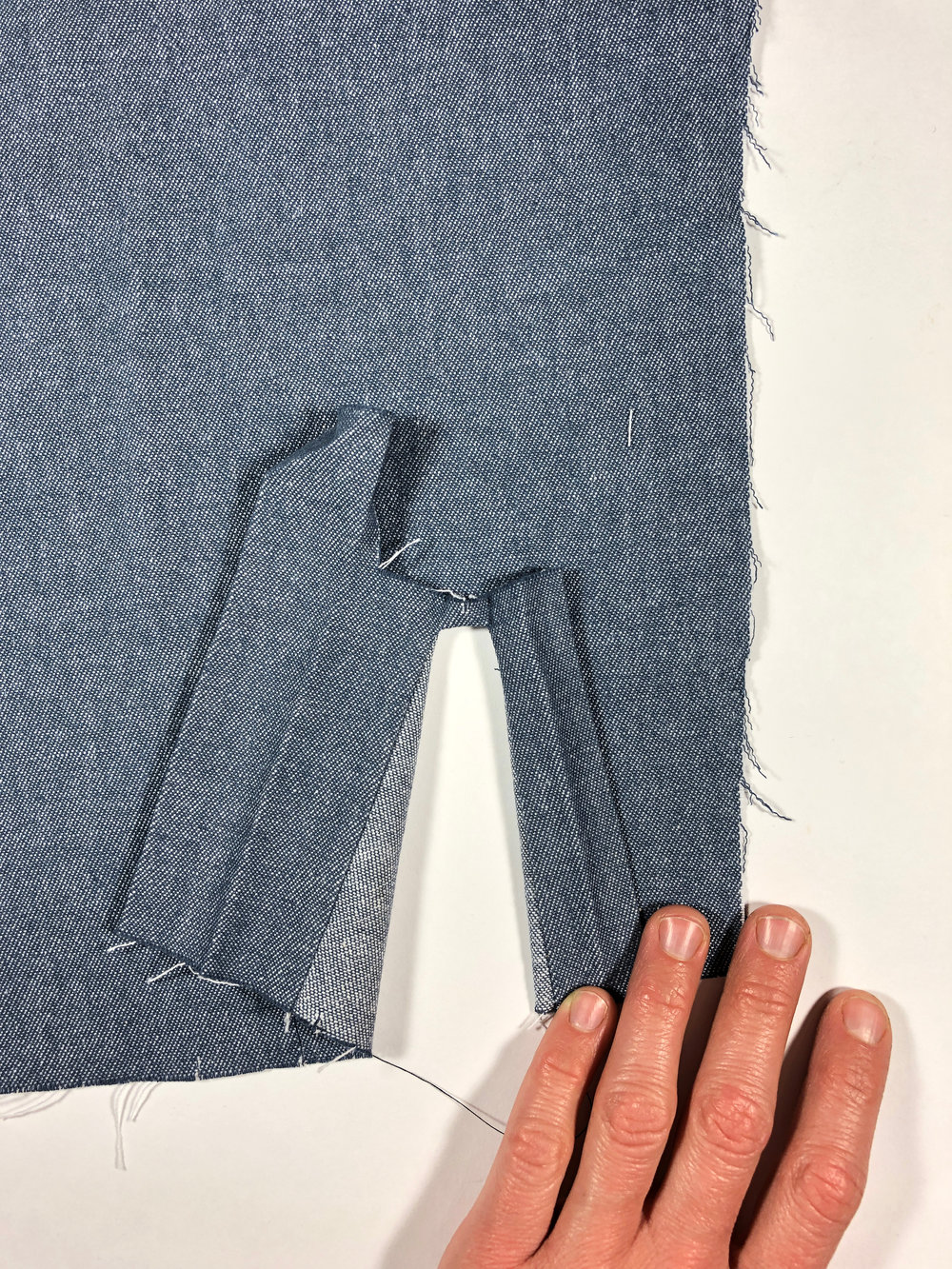 53. Turn the placket through the box to the right side of the sleeve.