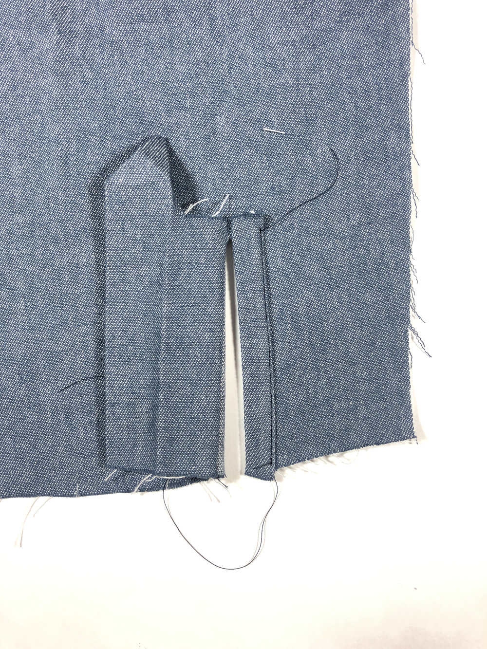 55. Edge stitch this side of the placket into place.