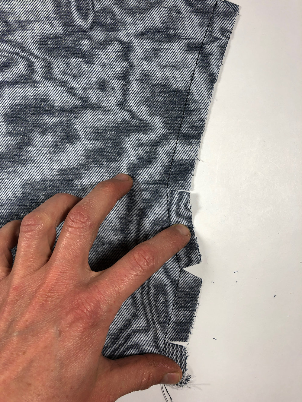 73. Clip into the seam allowance as shown. Clip into top and bottom angles, and clip a small triangle out of the middle angle.