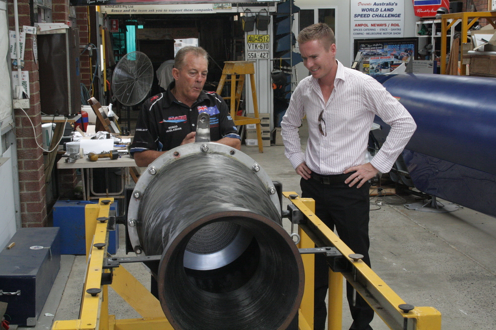 Albert with land speed record holder Rosco McGlashan and the engine of his new rocket-powered car - The Aussie Invader 5R.