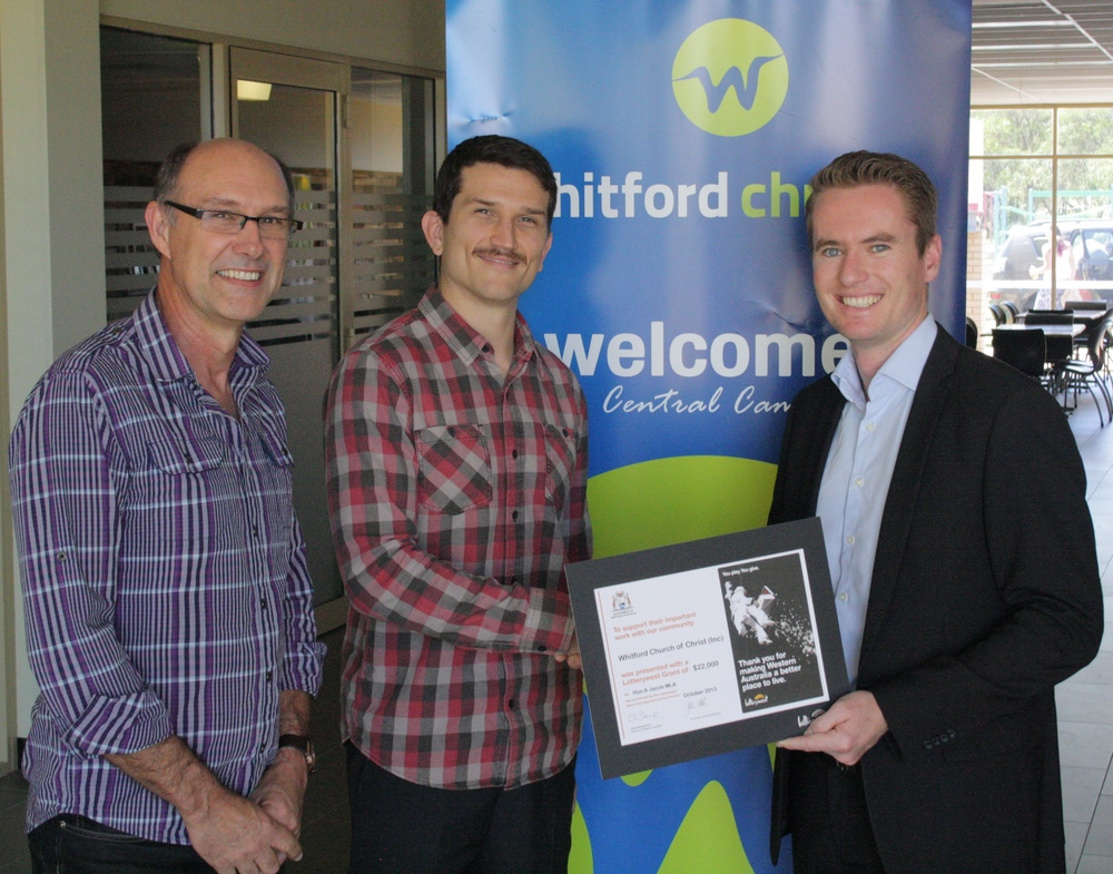 Albert presenting a Lotterywest cheque to Whitford Church to assist them with the Community Carols at Christmas.