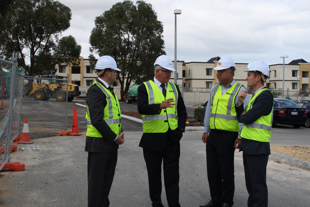 Albert discussing the car park with Minister Troy Buswell, Federal Member for Moore Ian Goodenough, and Joondalup MLA Jan Norberger.