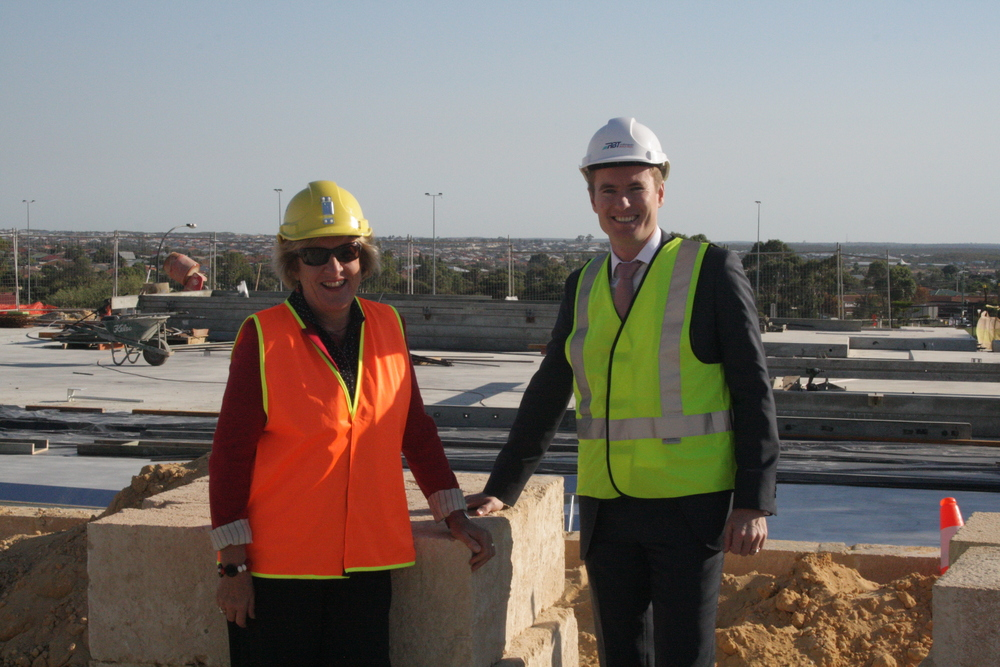 Albert at the gymnasium construction site with Principal Janice Sander of Mindarie Senior College.