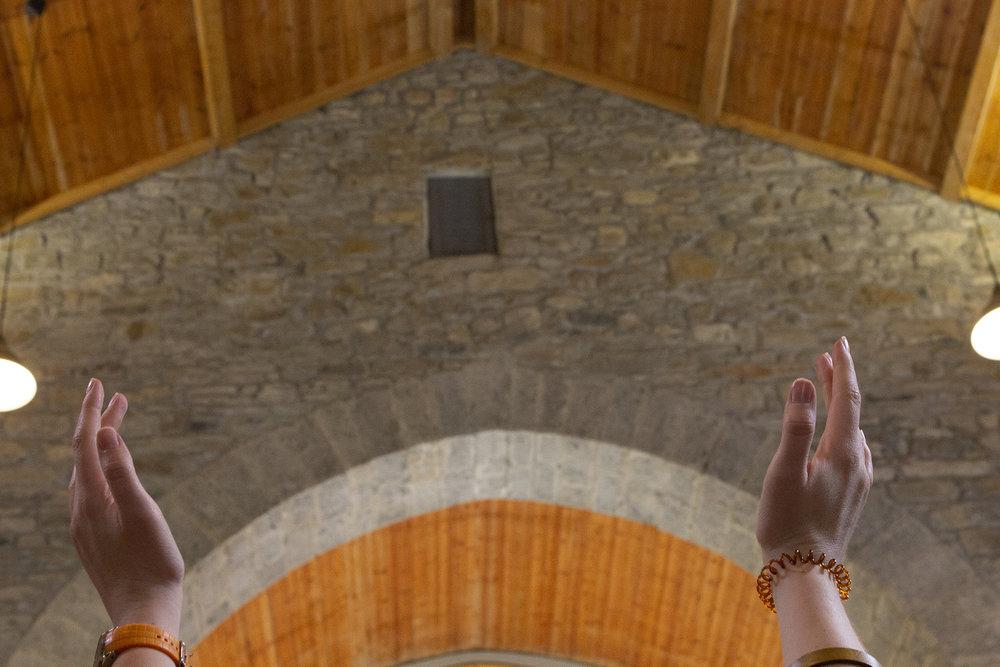 Hands Raised in Church.jpg