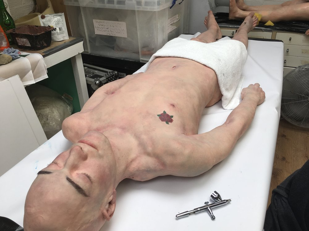 Silicone dummy I painted and hair punched at Lifecast. Body will be used for police training.
