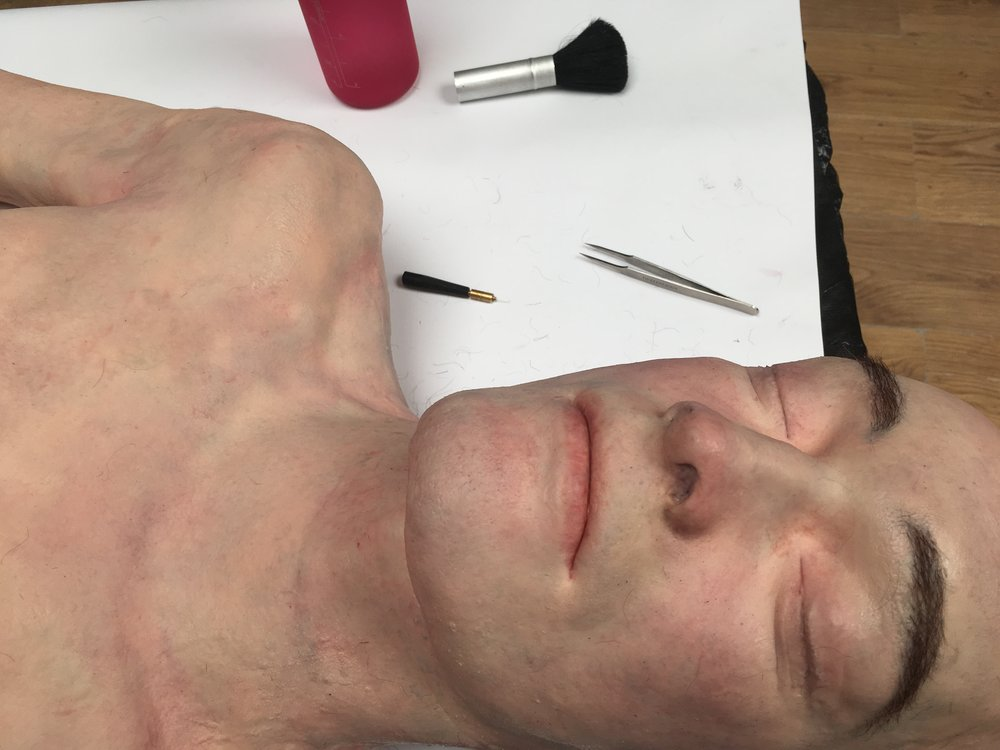 Silicone body dummy to be used for police training, I painted and hair punched