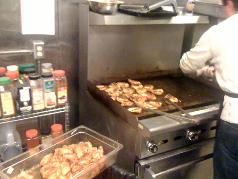 Grilling chicken at the Orion Center.