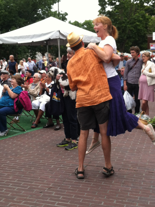A couple dancing to the band.