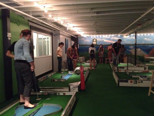 """Flatstick Pub: Mini Golf Elite Event"" by Yelp Inc. via Flickr Licensed under https://creativecommons.org/licenses/by-nc-nd/2.0/"