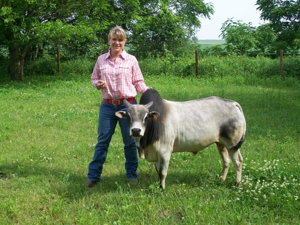 State Rep. Amy Loudenbeck. Given the title of this podcast, I thought I would show this picture of her with a miniature cow -- and provide absolutely no explanation for it.
