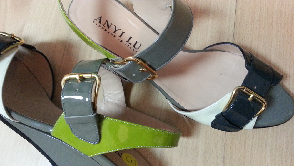 Patent Anyi Lu size 38 sandal wedge in cream, lime, and grey. These retail for around $395.00 and we have them for only $65.50 - they are not only stylish but look really comfortable