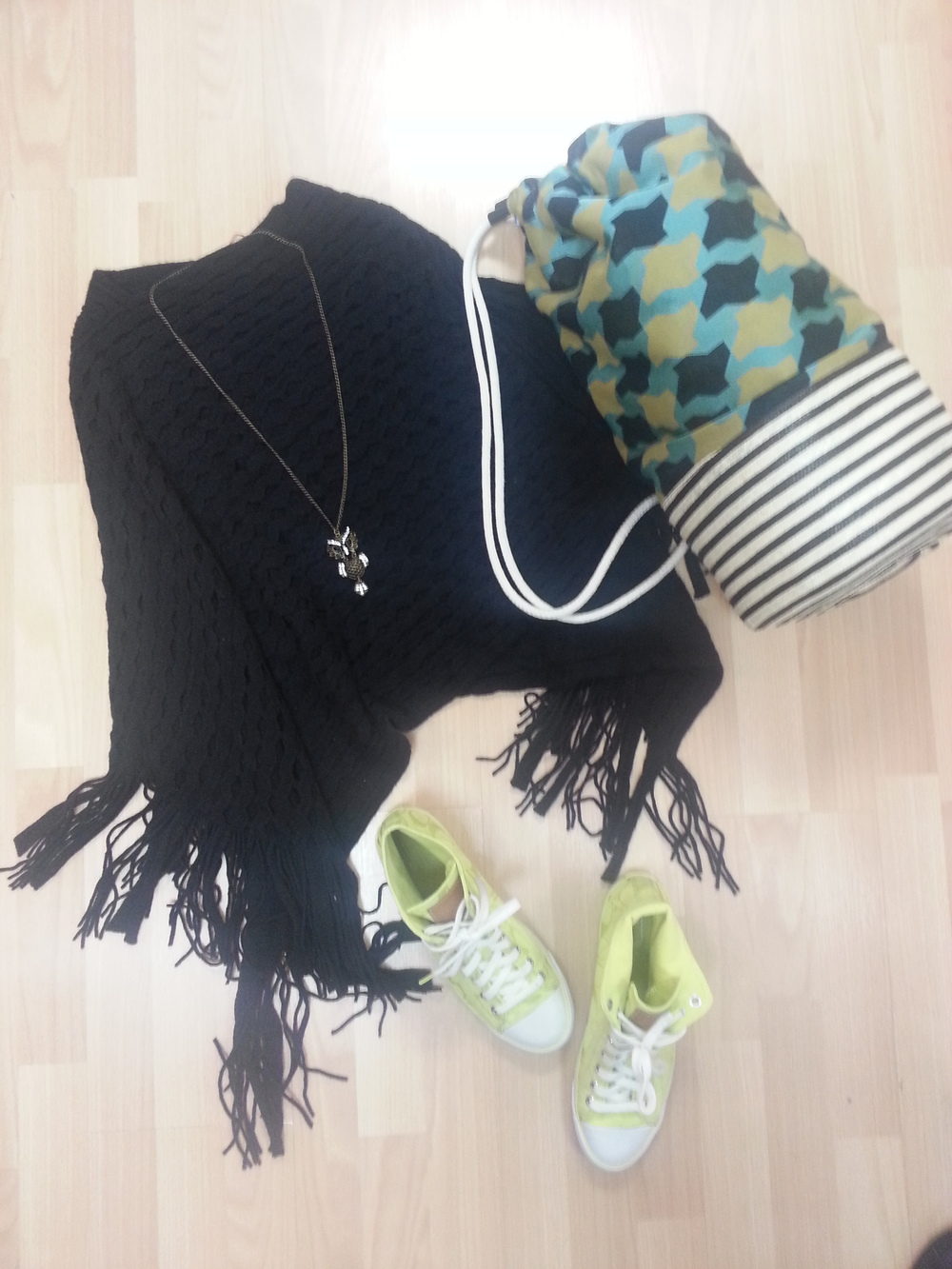 High top sneakers, black waffle weave fringe poncho, fun owl necklace, colorful Marni tote for your local market finds