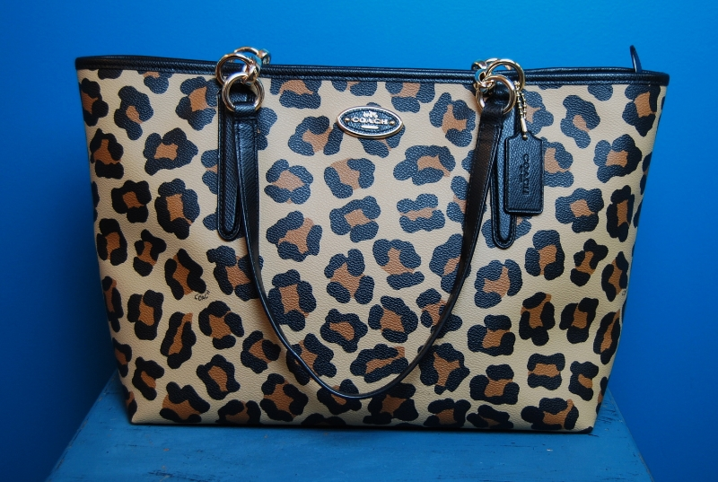 Leopard tote by  Coach . $125.50