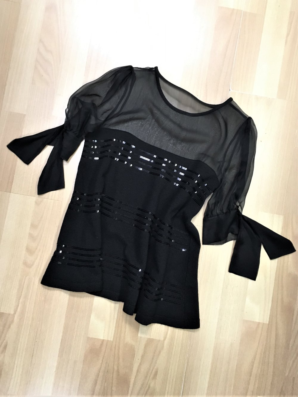 VALENTINO - Black wool blend sweater with sequin detail and sheer sleeves. Size small, $88.00