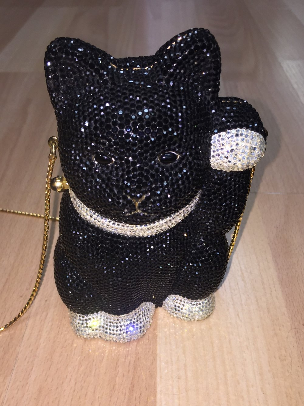 JUDITH LEIBER - Black and clear cat clutch, $1,650