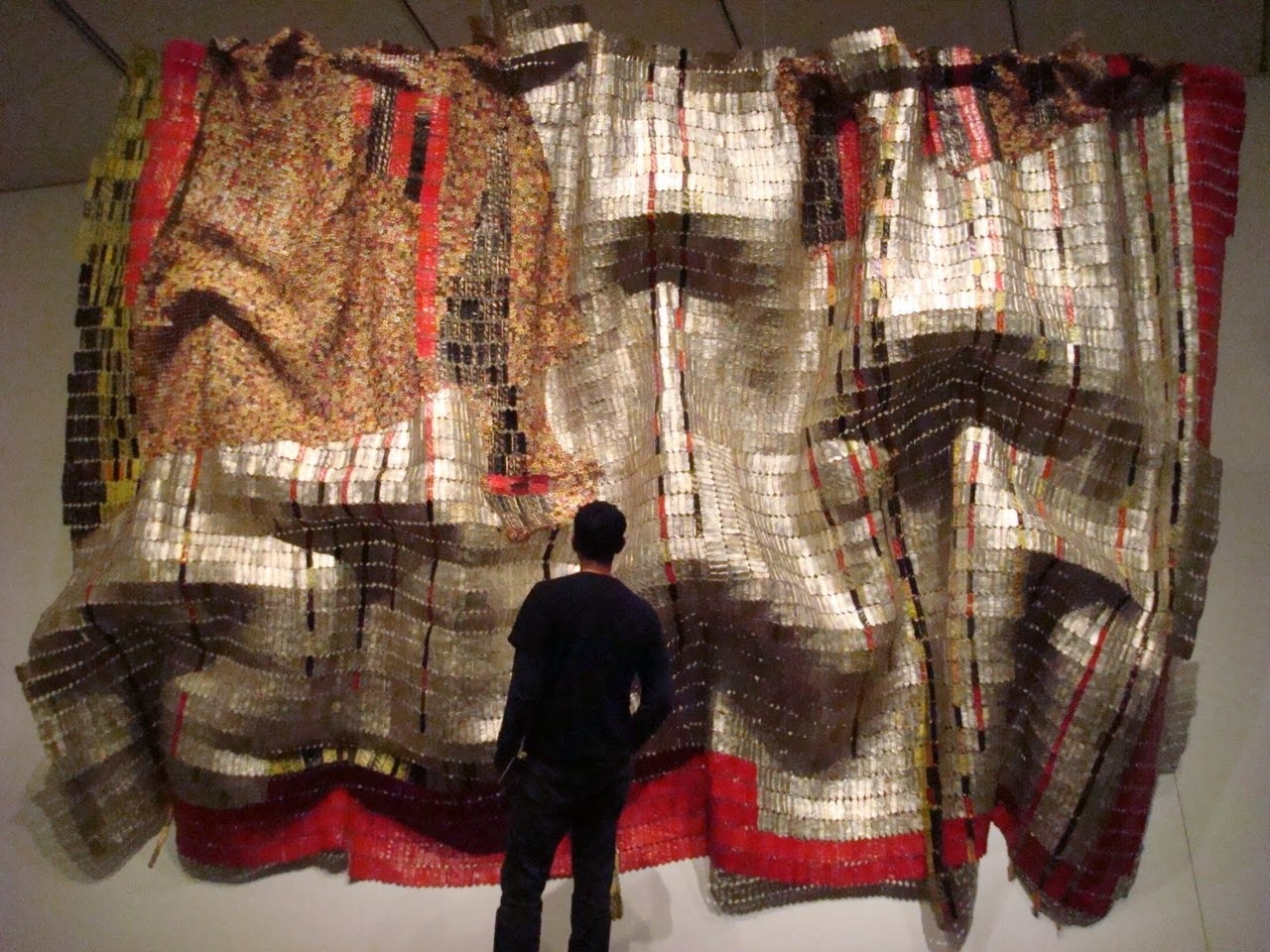 El Anatsui, Embrace, recycled liquor wrappers.